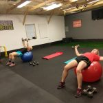 dumbbell flyes on stability balls