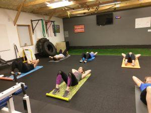 standard floor crunches being performed in boot camp class in catalyst 4 fitness studio