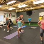 stationary forward lunges being performed in boot camp class in catalyst 4 fitness studio
