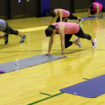 mountain climbers in group fitness class