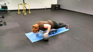 push up with one hand on medicine ball
