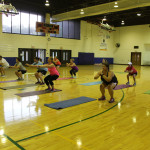 bodyweight squats in group fitness class
