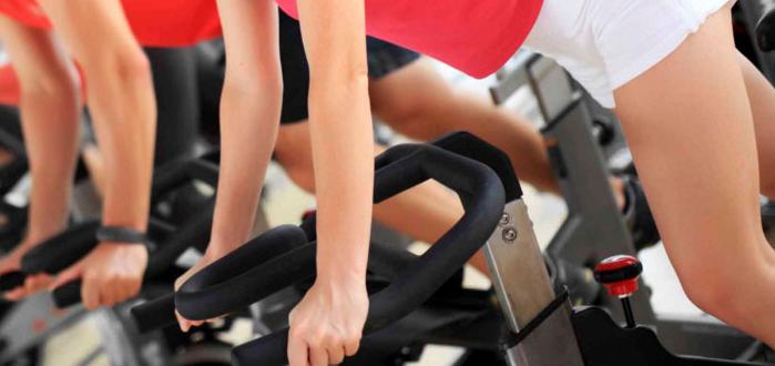 women on exercise bikes