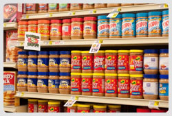 peanut butter jars on shelves in grocery store