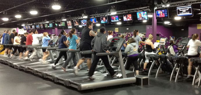 the cardio room of a busy gym
