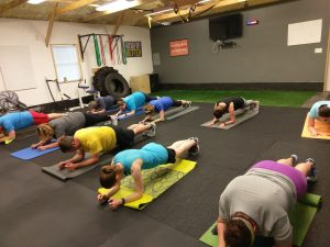 plank being performed in boot camp class in catalyst 4 fitness studio