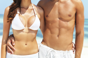 woman and man showing off their abdominal muscles