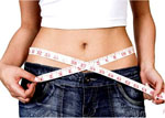 woman with tape measure showing weight loss
