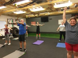 shoulder 6 way exercise in a small group fitness class in catalyst 4 fitness studio