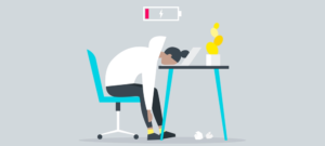 cartoon person exhausted with head on desk