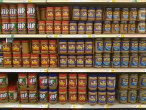 jars of peanut butter on grocery store shelves