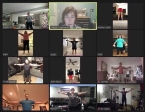 lateral raises performed during virtual fitness class for catalyst 4 fitness