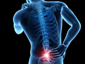 lower back pain highlighted on man's body
