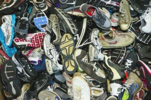 pile of old worn out sneakers